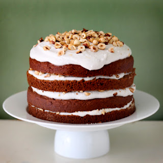 Pumpkin Spice Birthday Cake with Coconut Vanilla Icing and Roasted Hazelnuts.