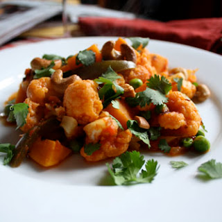 Cauliflower and Sweet Potatoes in Spicy Tomato Sauce with Cashews