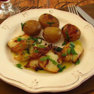 Cuttlefish With Potatoes In The Oven.