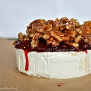 Baked Brie with Cranberry Chutney and Carmelized Pecans.