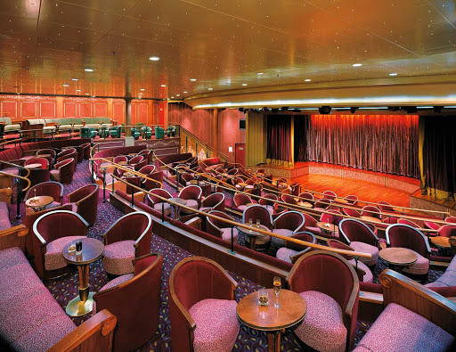 Silversea_theater - The plush theater aboard Silver Whisper is big enough for Broadway-style shows. Performances take place daily.