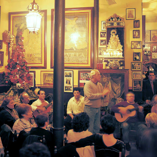 Taberna-Flamenca-Seville-Spain - In the taverns throughout Spain, you can hear live music and join in the singing. You might even catch a traditional Flamenco dance.