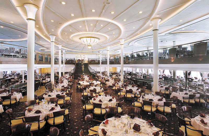 Dine at the My Fair Lady dining room on decks 4 and 5 of Enchantment of the Seas, which a grand staircase and waterfall that that recall scenes in the movie.