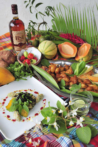 Food-Le-Bredas-Martinique - A spread with local cuisine at an even showcasing art, cuisine and culture in Martinique.