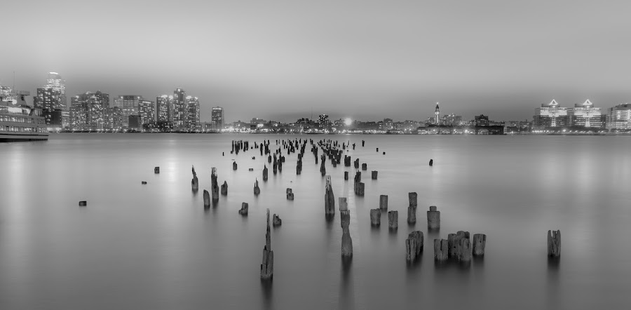 Calm water by Glenn Santos - Black & White Landscapes ( water, black and white, city lights, night, long exposure,  )