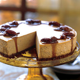 Spiced Pumpkin Cheesecake with Caramel-Bourbon Sauce.