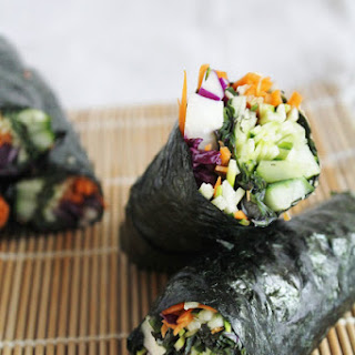 Raw Nori Wraps With Red Cabbage, Cucumber, Carrots, Zucchini & Spicy Dipping Sauce.