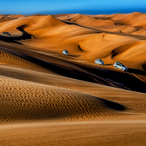 On Tour by Johan Jooste Snr - Landscapes Deserts ( dunes, convoy, namib desert, desert, tourgroup, 4x4 vehicles, namibia )