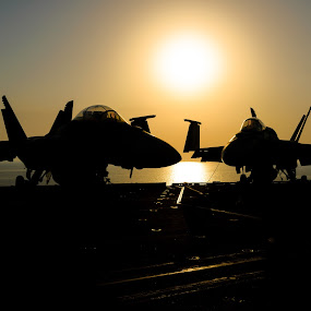 Sunset over the Gulf by Justin Orr - News & Events World Events ( f-18, airplanes, silhouette, sunset, carrier, war,  )