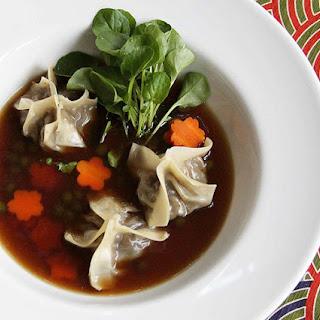 Mushroom Broth with Smoked Eggplant Dumplings.