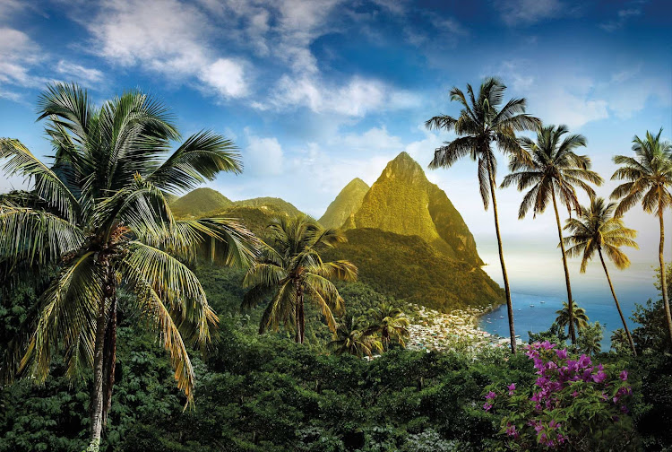 The Pitons, two mountainous, lush volcanic spires, loom over Saint Lucia.