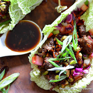 North African Spiced Beef Ribeye Wraps with Crunchy Confetti Slaw & Carrot Marmalade Soy Sauce.