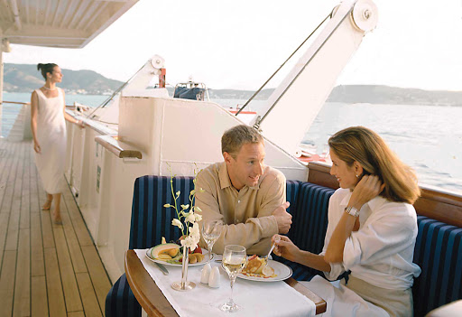 Enjoy private al fresco dining options such as this alcove on board your SeaDream cruise.