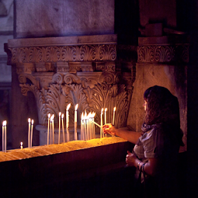 Lighting candles at the Church of the Holy Sepulchre by Yeshaya Dinerstein - People Group/Corporate ( candle, prayer, christians, jerusalem, church, holy sepulchre, churches, candles, holy, holy places, israel, holy land )