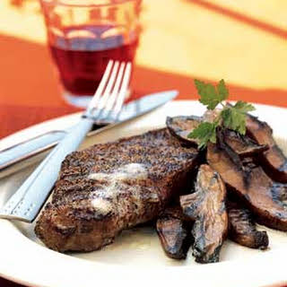 Pepper-Crusted Steaks with Worcestershire-Glazed Portobellos.