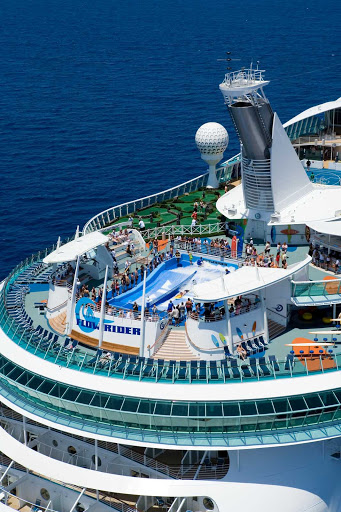 Liberty-of-the-Seas-aft-2 - Liberty of the Seas, staffed with a crew of over 1,300, offers a wide assortment of onboard experiences, including 10 pools and whirlpools, the popular FlowRider, more than100 spa treatments and multiple  entertainment options.