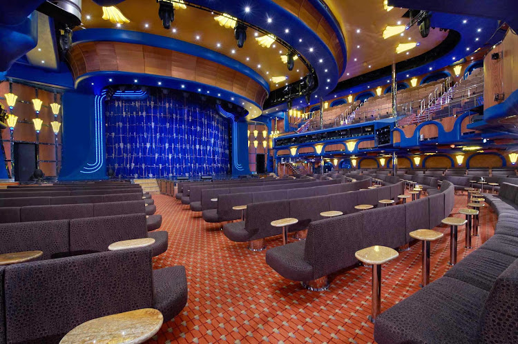 Put your hands together during performances in the Ovation Theater during your Carnival Breeze cruise.