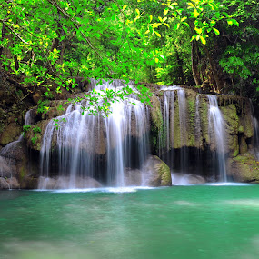 Deep forest waterfall at Erawan waterfall National Park  by Tom Ruethai - Landscapes Waterscapes ( wood, relax, purity, thailand, rock, leaf, vibrant, preserve, conserve, fluid, nature, tree, foliage, motion, wonderful, cool, wild, forest, vacation, jungle, cataract, plant, stream, waterfall, tropical, landscape, exotic, spring, clean, fresh, swim, creek, wet, water, park, heaven, flowing, green, beautiful, scenic, paradise, torrent, national park, cascade, background, fall, freshness, scenery, growth, river )