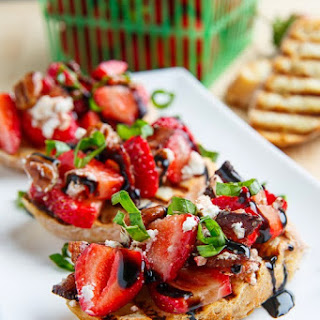 Strawberry Bruschetta with Bacon, Candied Pecans and Goat Cheese with a Balsamic Drizzle.
