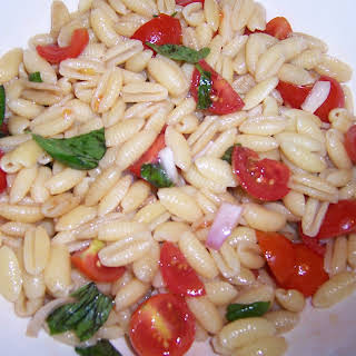 Orecchini Pasta Salad with Red Onions, Tomatoes, Basil and Balsamic Vinegar.