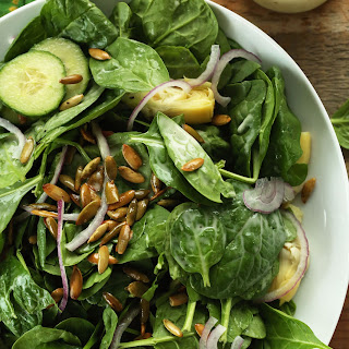 Spinach Salad with Toasted Pepitas and Creamy Vegan Dressing.