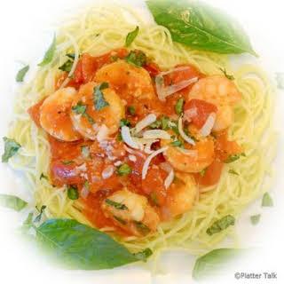Garlic and Basil Shrimp over Angel Hair Pasta.