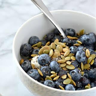 Greek Yogurt Breakfast Bowl with Blueberries and Pumpkin Seeds.