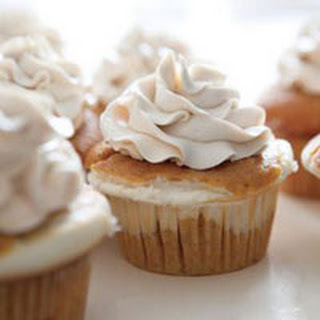 Cheesecake-Filled Pumpkin Cupcakes.