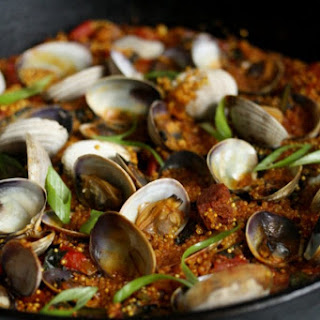 Quinoa Paella with Clams, Chorizo and Winter Greens