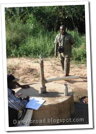 "Foster showing a ""Mark V"" pump installed on a shallow well by the Marion Medical Mission, one of the active NGOs in the area"