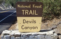 Road sign for trail to Devils Canyon.