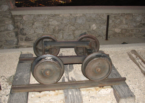 Wheels from the local narrow gauge railroad cars and some track displayed next to the pavillion.