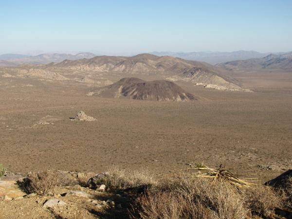 The desert valley below.