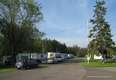 Row of single wide mobile homes.