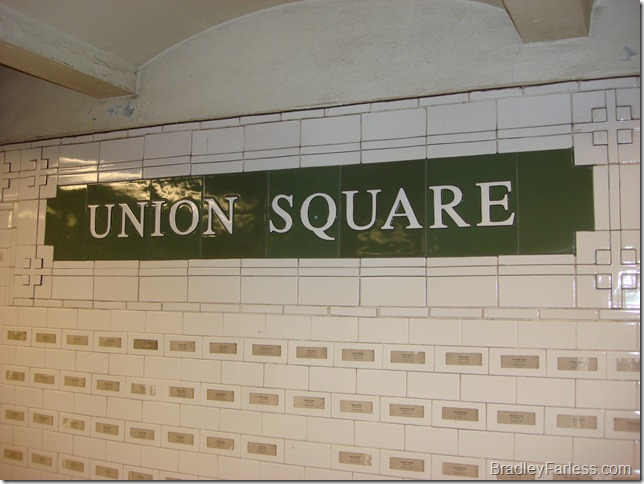 Name stickers placed on tiles in Union Square station, each of a person who died on September 11th, 2001.