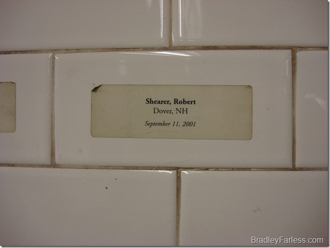One of the stickers on the tiles in Union Square station, showing the name of a person who died on September 11th, 2001.