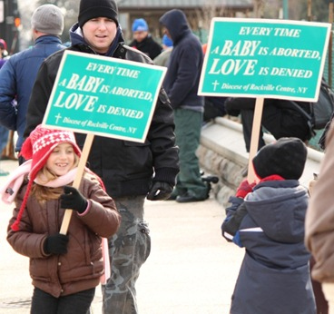 Children with anti-abortion placards