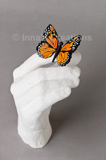 Quilled butterfly with plaster cast hand