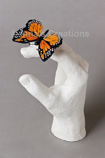 Quilled butterfly on plaster cast finger