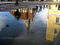 St. Michael church reflection in a puddle
