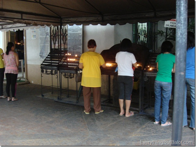 People lighting candles as offerings at Antipolo Cathedral