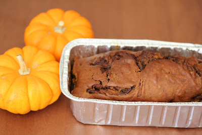 photo of a loaf of Nutella Swirl Pumpkin Bread in a pan
