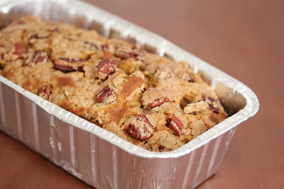 photo of a Pecan Streusel Pumpkin Bread in a loaf pan