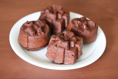 photo of four chocolate cakelets on a plate