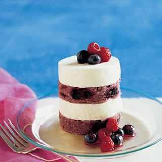 Individual Red, White, and Blueberry Layer Cakes.