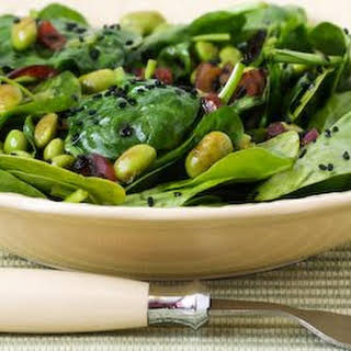 Wilted Spinach Salad with Edamame, Red Onion, and Black Sesame Seeds.