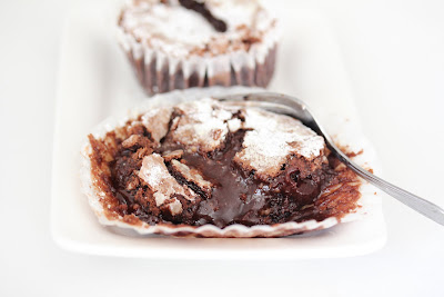 close-up photo of a cake with chocolate oozing out