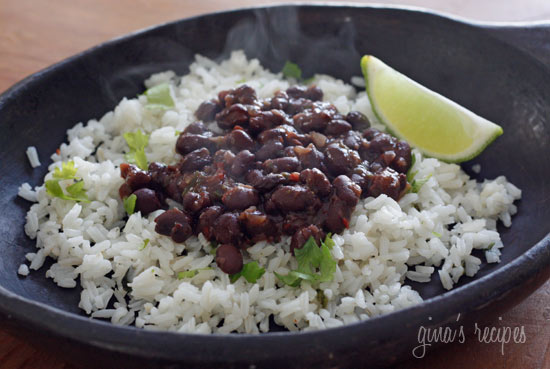 Get your Latin groove on with these Cuban-inspired black beans loaded with mucho sabor (lots of flavor)!  Easy to make and ready in twenty minutes, but don't let that fool you, these beans have a lot of flavor.  Low in fat, super rich in fiber, vegan, gluten-free, inexpensive and delicious!