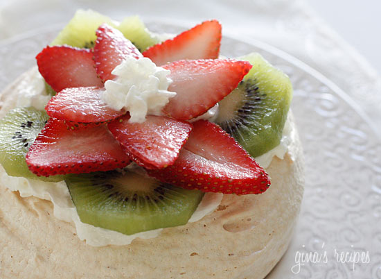 This Pavlova recipe is elegant yet light, made with whipped egg whites and sugar, then topped with cream and fresh fruit. The perfect light dessert!