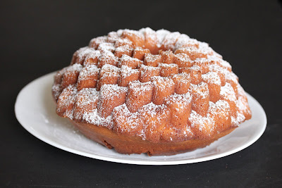 photo of a coconut tea cake dusted with powdered sugar